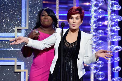 Sheryl Underwood (L) and Sharon Osbourne speak onstage during The 41st Annual Daytime Emmy Awards at The Beverly Hilton Hotel on June 22, 2014 in Beverly Hills, California.