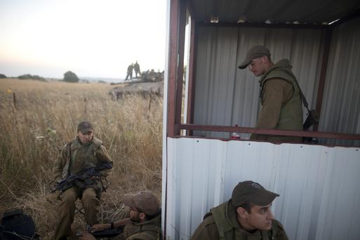 Israeli soldiers deploy on the Israeli-Syrian border near Quneitra. (Photo by Lior Mizrahi/Getty Images)