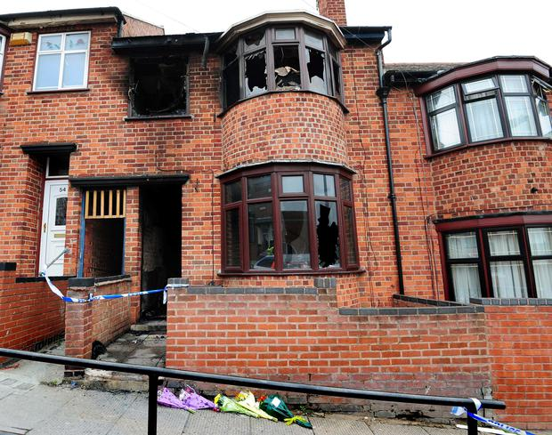 A general view of the scene of the fatal house fire in Wood Hill, Leicester, as Kemo Porter and Tristan Richards have been found guilty at Nottingham Crown Court of murdering a mother and her three children in a house fire in Leicester in the early hours of September 13 last year