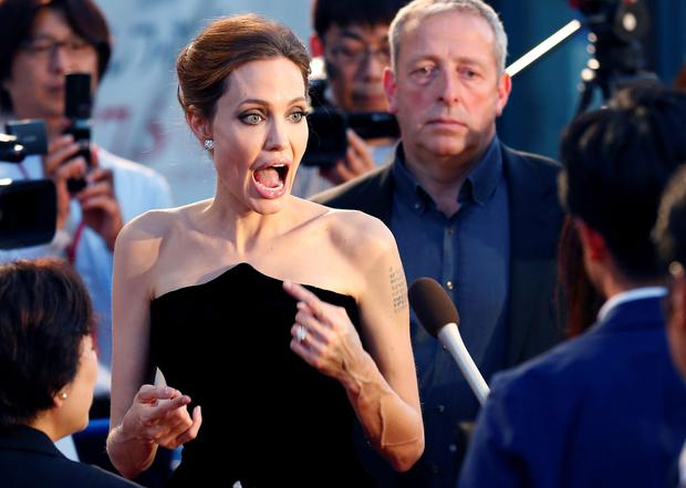 Angelina Jolie reacts as she arrives at the Japan premiere of