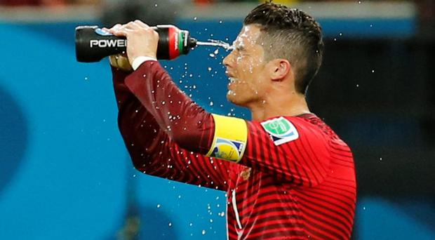Portugal's Cristiano Ronaldo takes a water break during the 2014 World Cup G soccer match between Portugal and the U.S. last night