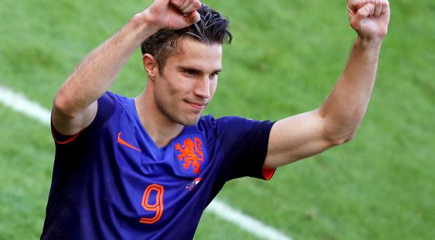 Robin van Persie of the Netherlands waves after the 2014 World Cup Group B soccer match against Australia at the Beira Rio stadium