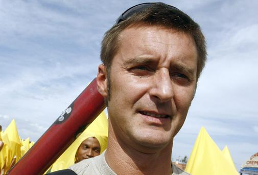 Environmental organization Greenpeace France's director Pascal Husting during a demonstration to ask for an civilian inspection of the Missile Test Center, 23 September 2006 in Biscarosse south-western France. AFP PHOTO JEAN PIERRE MULLLER (Photo credit should read JEAN-PIERRE MULLER/AFP/Getty Images)