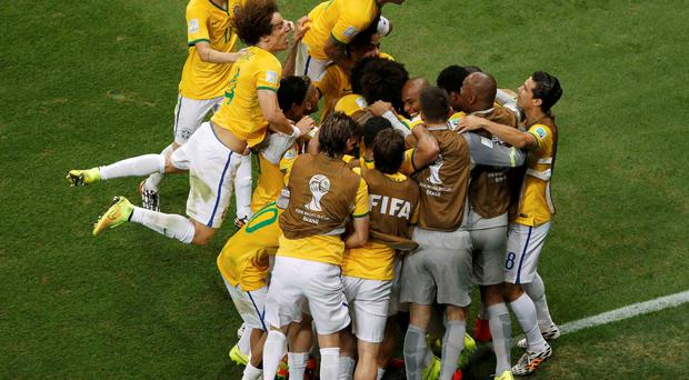 Brazil's Fernandinho celebrates after scoring a goal with teammates during their 2014 World Cup Group A soccer match against Cameroon at the Brasilia national stadium