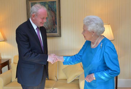Britain's Queen Elizabeth meets Northern Ireland's Deputy First Minister Martin McGuinness during a private audience at Hillsborough Castle June 23, 2014.