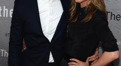 Actors Justin Theroux and Jennifer Aniston attend