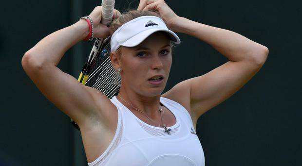 Caroline Wozniacki in action during her women's singles tennis match against Shahar Peer of Israel