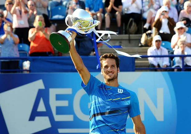 Feliciano Lopez with the Men's Singles trophy after beating Richard Gasquet in the final during the AEGON International at Devonshire Park, Eastbourne.