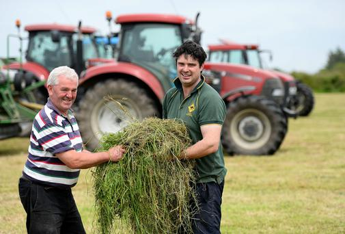 Nelus O'Connor (on right) of Nelus O'Connor Agri Contractors at work on the farm of Timmy Kennelly from Moyvane, Co Kerry. Photo: Domnick Walsh