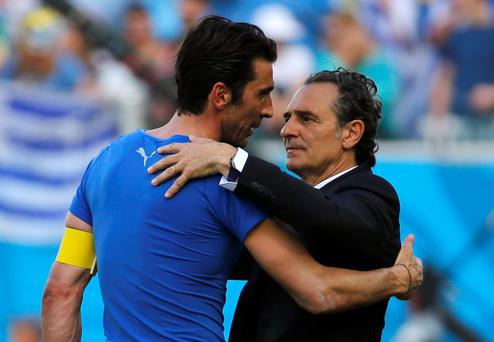 Italy's goalkeeper Gianluigi Buffon and coach Cesare Prandelli hug after the 2014 World Cup Group D soccer match between Uruguay and Italy.