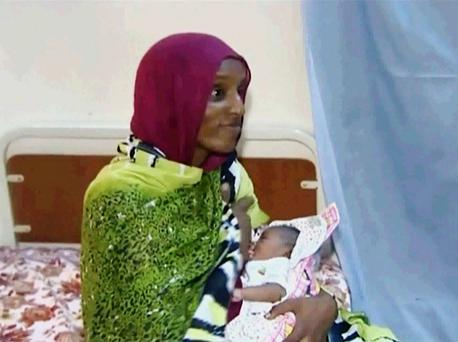 Meriam Ibrahim breastfeeds her newborn baby girl, Maya, who she gave birth to in prison. AP