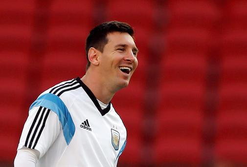 Lionel Messi smiles during a training session