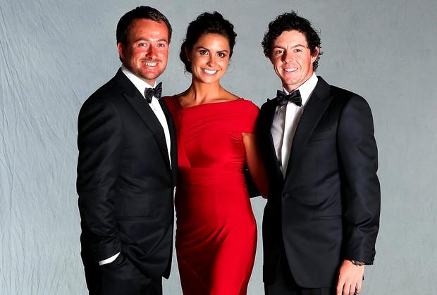 Graeme McDowell (L) poses with his girlfriend Kristin Stape and Rory McIlroy (R) for a portrait at the Ryder Cup host hotel prior to the start of the 39th Ryder Cup Gala on September 26, 2012 in Lombard, Illinois.