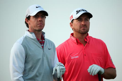 Rory McIlroy (left) and Graeme McDowell of Northern Ireland stand together on the 15th hole during the first round of the BMW Masters at Lake Malaren Golf Club on October 24, 2013 in Shanghai, China.