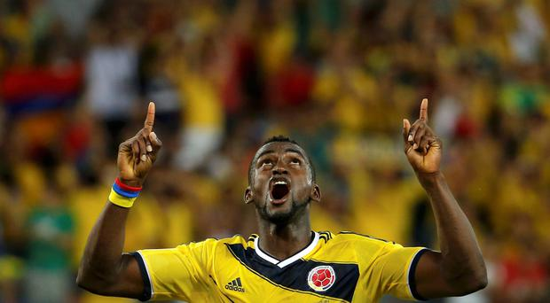 Colombia's Jackson Martinez celebrates after scoring his second goal during the 2014 World Cup Group C soccer match between Japan and Colombia at the Pantanal arena in Cuiaba