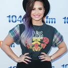 Singer Demi Lovato absolutely nails the purple ombre hair trend