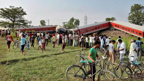 A passenger train derailed early Wednesday in the eastern Indian state of Bihar, killing at least four people and injuring eight others, officials said. The cause of the accident was not immediately known. (AP Photo)