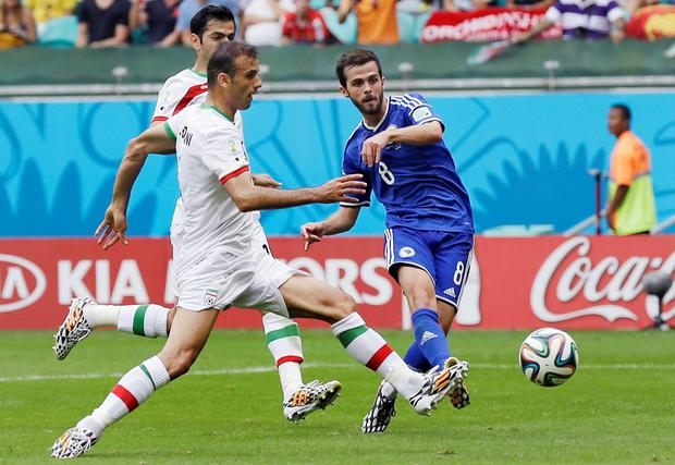 Bosnia's Miralem Pjanic shoots to score his teams second goal during the group F World Cup soccer match between Bosnia and Iran at the Arena Fonte Nova in Salvador