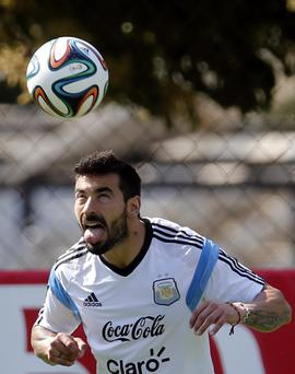 Argentina's national soccer player Ezequiel Lavezzi heads the ball during a training session at Ciudad do Galo grounds in Vespasiano, outside Belo Horizonte