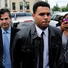 Rapper Chris Brown arrives at the DC Courthouse in Washington. Brown is appearing in regard to a misdemeanor assault charge and must be present for a plea deal. Photo: REUTERS/Gary Cameron