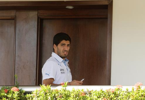 Uruguay's Luis Suarez uses his cell phone at a hotel in Natal today
