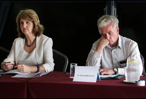 Peter McVerry sits alongside Minister for Social Protection Joan Burton at the launch of the The Peter McVerry Trust Annual Report 2013.