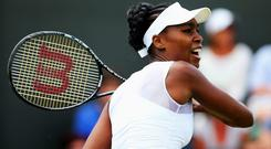 Venus Williams plays a forehand shot during her Ladies' Singles second round match against Kurumi Nara of Japan