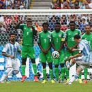 Argentina's Lionel Messi scores on a free kick during the 2014 World Cup Group F soccer match against Nigeria at the Beira Rio stadium in Porto Alegre. Photo credit: REUTERS/Stefano Rellandini