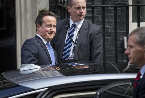 David Cameron leaves number 10 Downing Street yesterday to attend Prime Minister's Questions, where he faced questions about the conviction of Andy Coulson, his former director of communications, in the phone hacking trial. Photo: Rob Stothard/Getty Images