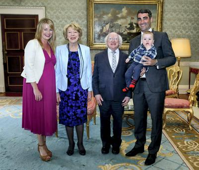 President Higgins and his wife Sabina as they meet with Claire Byrne with Gerry Scollan and their baby Patrick during a Ethics Garden party in Aras An Uachtarain. Photo: Maxwell's