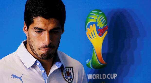 Luis Suarez faces being kicked out of the World Cup - and potentially a lengthy international ban. Photo: REUTERS/Carlos Barria