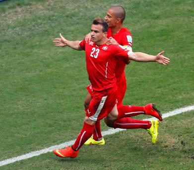 Switzerland's Xherdan Shaqiri (23) celebrates scoring his side's first goal during the group E World Cup soccer match between Honduras and Switzerland at the Arena da Amazonia in Manaus