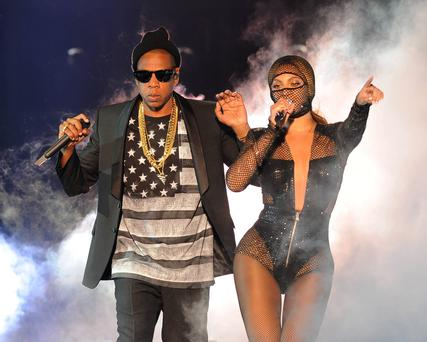 Beyonce and JAY Z perform on the opening night of the On The Run Tour at Sun Life Stadium on Wednesday, June 25, 2014, in Miami, Florida. (Photo by Jeff Daly/Invision for Parkwood Entertainment/AP Images)
