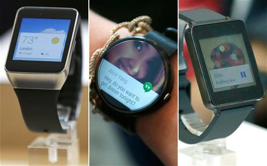 (From left) A Samsung Gear Live watch, Motorola Moto 360 watch and LG's G watch