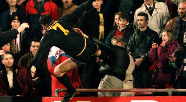 Man Utd' s Eric Cantona jumps into the crowd with his infamous Kung- Fu kick on a Palace supporter after being sent-off