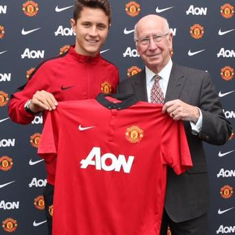 Ander Herrera with Manchester United great Bobby Charlton