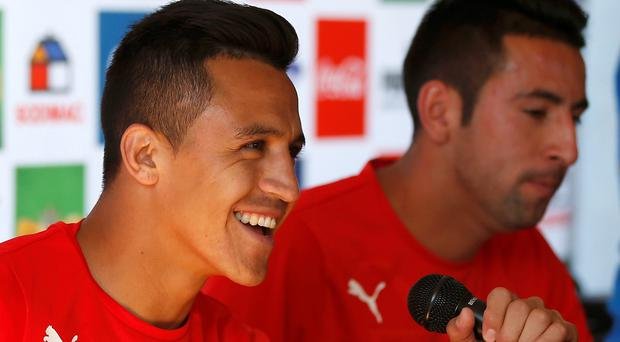 Chile's national soccer players Alexis Sanchez (L) and Mauricio Isla attend a news conference at Toca da Raposa II in Belo Horizonte
