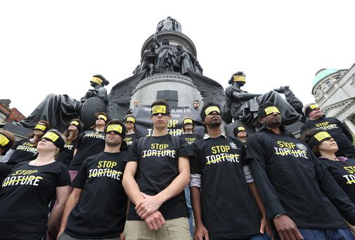 Local amnesty international activists pictured in front of the Daniel O'Connell Monument in Dublin. Picture: Damien Eagers