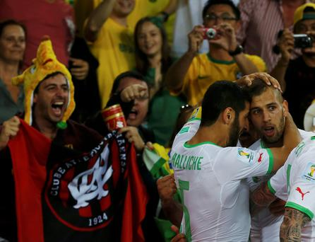 Algeria's Islam Slimani (R) celebrates after scoring a goal with teammate Rafik Halliche during their 2014 World Cup Group H soccer match against Russia at the Baixada arena in Curitiba