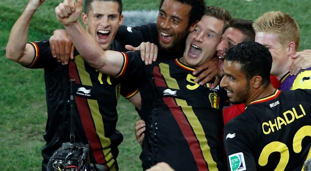 Belgium's Jan Vertonghen (5) celebrates his goal with team mates during their 2014 World Cup Group H soccer match against South Korea at the Corinthians arena in Sao Paulo