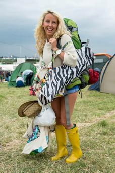 A festival goer wears wellington boots in preparation for rain during the Glastonbury Festival at Worthy Farm in Glastonbury. Getty Images