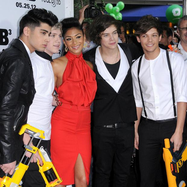 Nicole Scherzinger poses with One Direction members (l to r) Zayn Malik, Niall Horan, Harry Styles and Louis Tomlinson