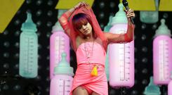 British singer Lily Allen performs on the Pyramid Stage at Worthy Farm in Somerset, during the Glastonbury Festival. Reuters/Cathal McNaughton
