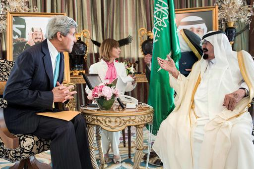 Saudi King Abdullah bin Abdulaziz al-Saud (R) and U.S. Secretary of State John Kerry wait for a meeting at the King's private residence in the Red Sea city of Jeddah June 27, 2014.