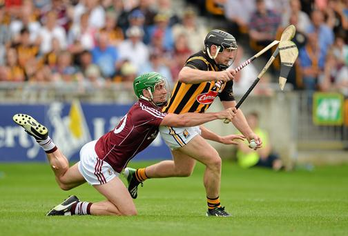Kilkenny's Richie Hogan has his hurl broken in two as he's challenged by Galway's David Burke during last week's clash. Picture credit: Piaras O Midheach / SPORTSFILE