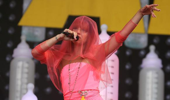 British singer Lily Allen performs on the Pyramid Stage at Worthy Farm in Somerset