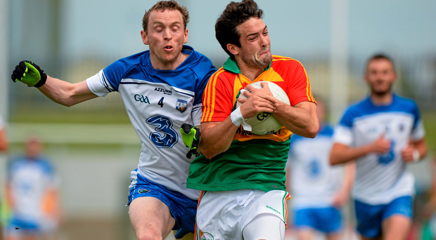 28 June 2014; Benny Kavanagh, Carlow, in action against Maurice O'Gorman, Waterford. GAA Football All Ireland Senior Championship, Round 1B, Carlow v Waterford, Dr. Cullen Park, Carlow. Picture credit: Piaras O Midheach / SPORTSFILE
