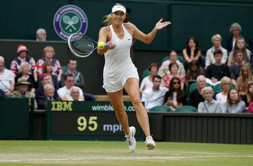 Maria Sharapova of Russia hits a return to Alison Riske of the U.S. during their women's singles tennis match at the Wimbledon