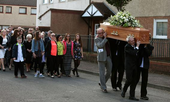 Birmingham Six member Paddy Hill, front left, helps carry the coffin of Gerry Conlon. Photo: Brian Lawles/PA