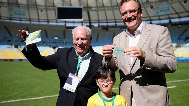 Joedir Belmont (85), left, handed his 1950 World Cup final ticket over to FIFA Secretary General Jerome Valcke